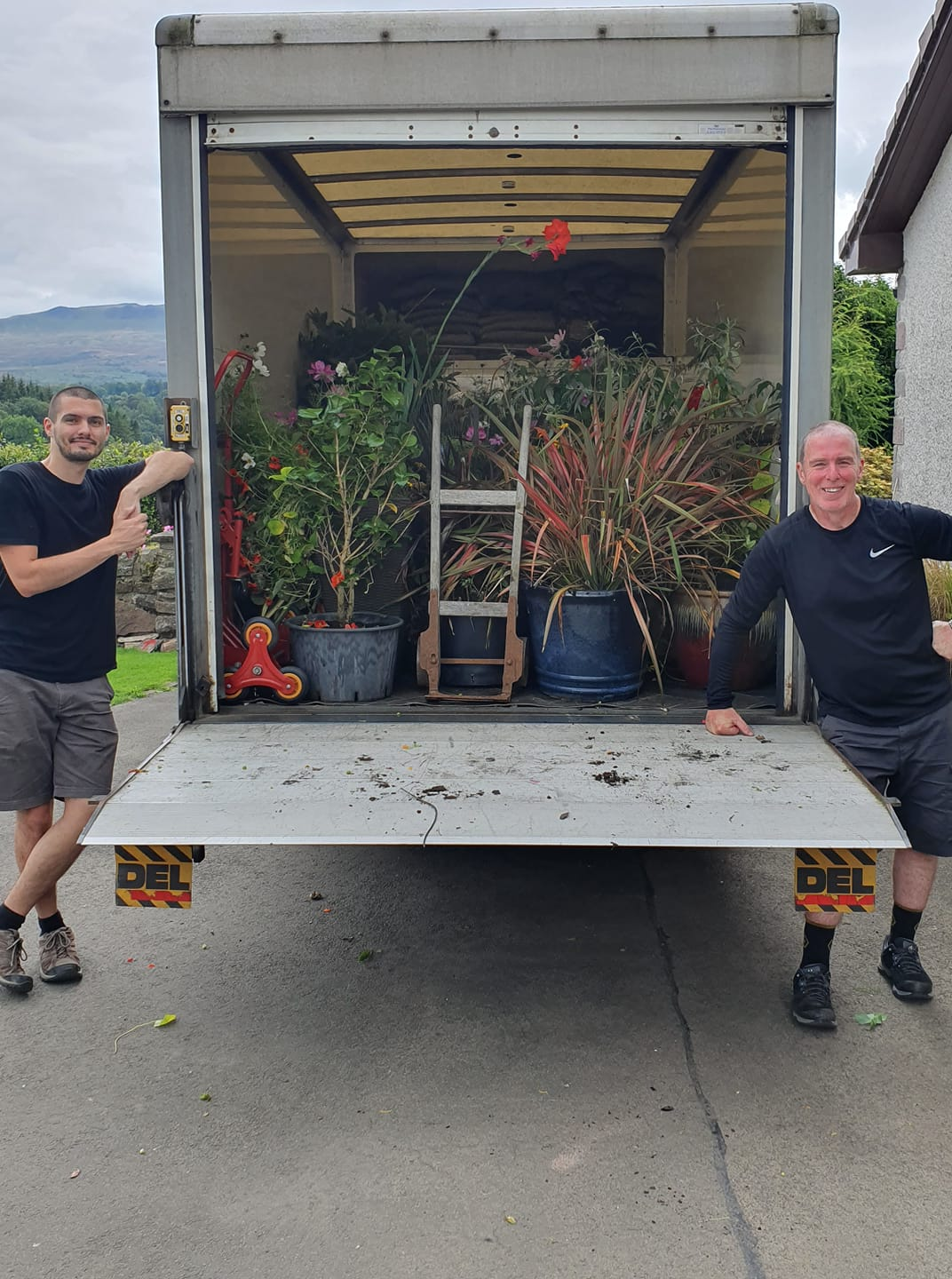 William and James with a van full of plants